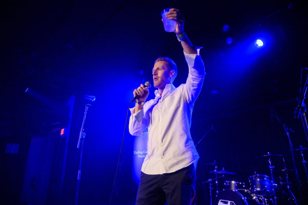FOL Board Member Brett Schweitzer raising a glass for a toast at the Lombardi Live concert